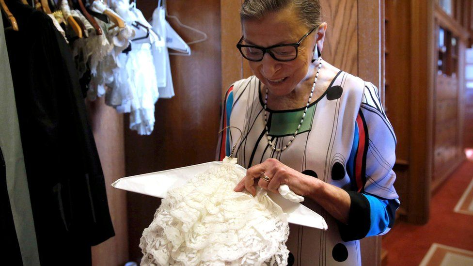 US Supreme Court Justice Ruth Bader Ginsburg shows the many different collars (jabots) she wears with her robes