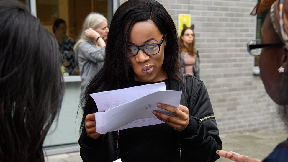 Student reads her A-level results