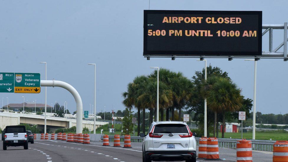 A sign at Tampa International Airport advises motorists of the closing of the airport as Elsa moves north on July 6, 2021