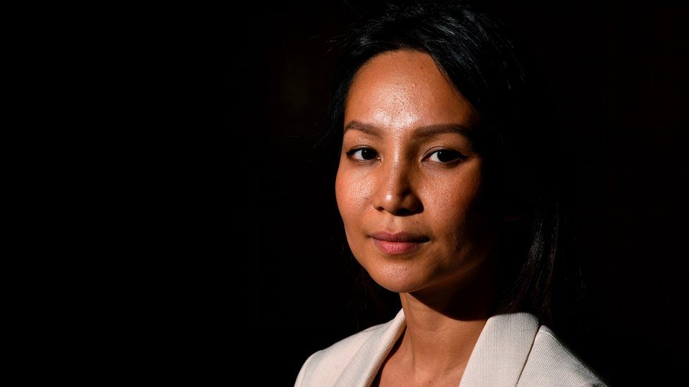 Monovithya Kem poses for a photograph following a press conference with NSW Opposition Leader Luke Foley at Parliament House in Sydney