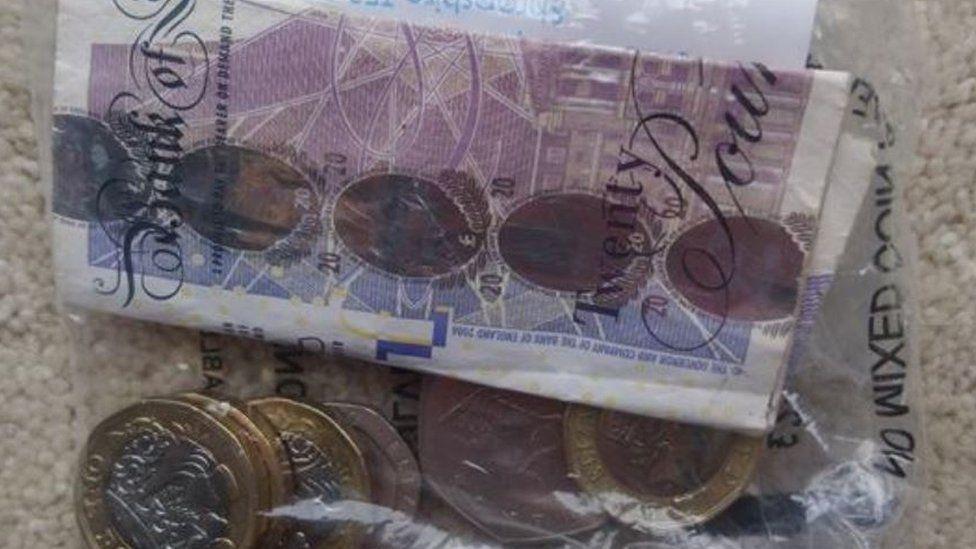 Money in plastic bag