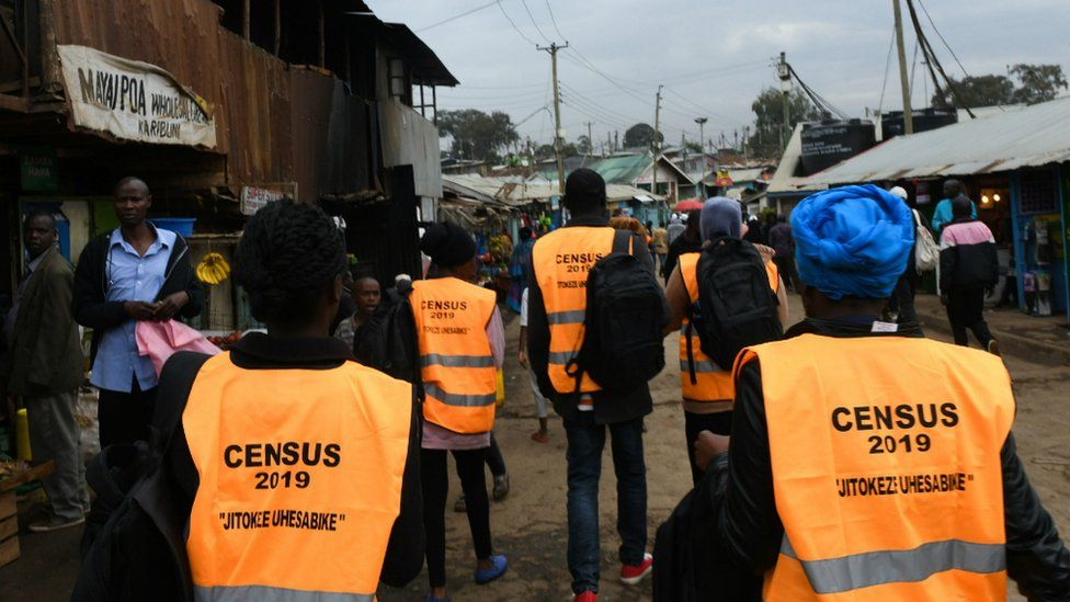 Census officials in street