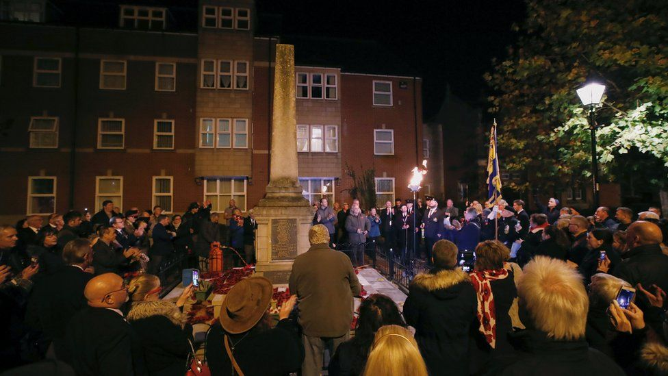 A beacon lighting ceremony takes place at the Rugeley War Memorial