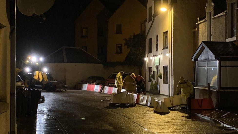 Erecting flood barriers in Stonehaven