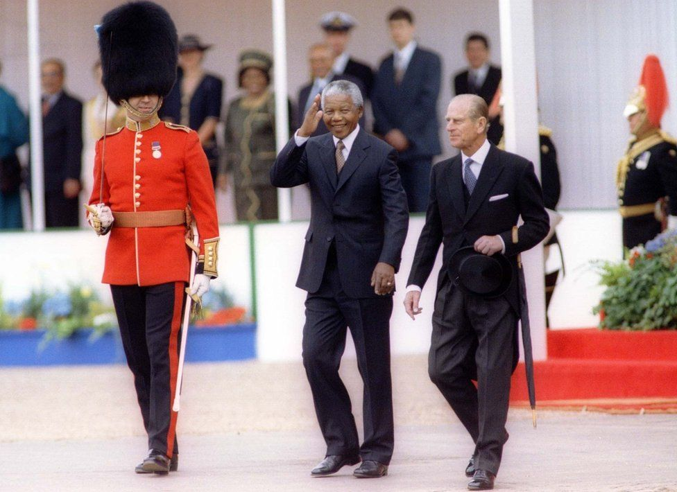South African President Nelson Mandela, accompanied by the Duke of Edinburgh