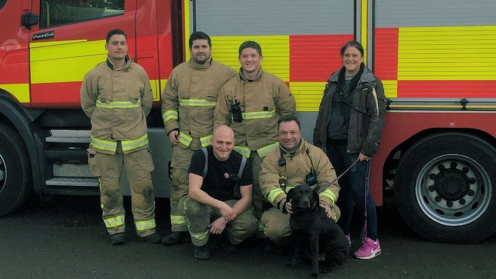 Corringham firefighters pose for a picture with Remi
