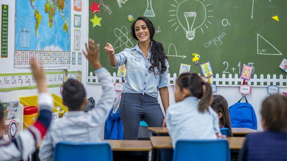 A teacher in a school