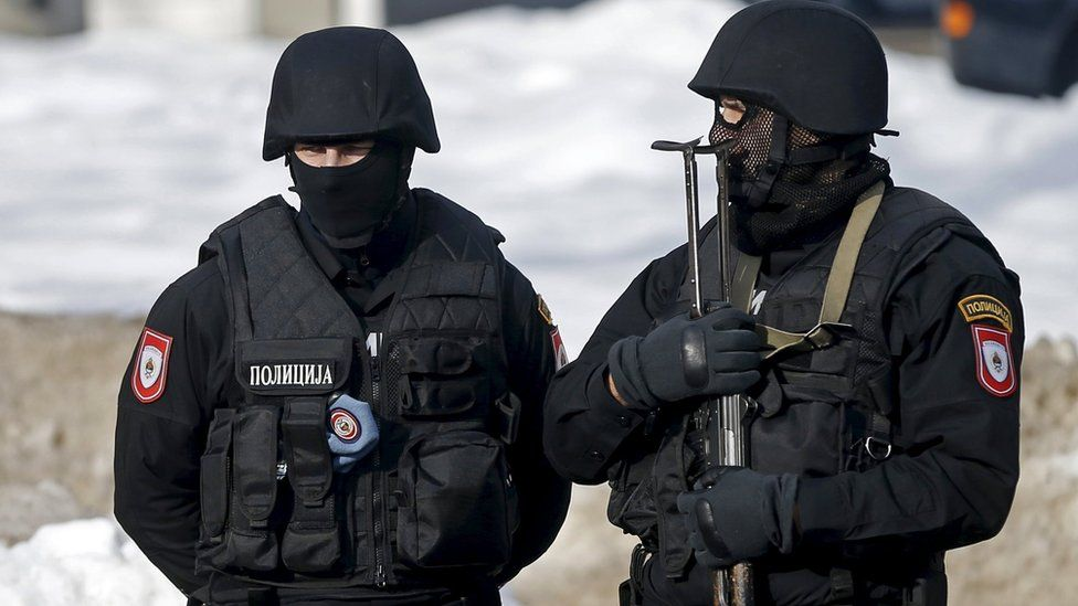Two armed Bosnian police stand guard in this 2016 file picture