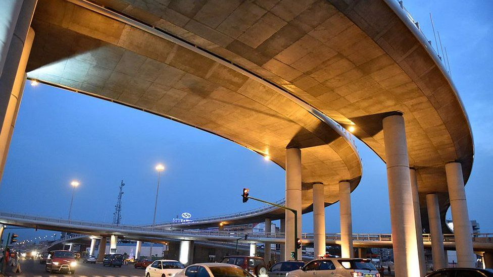 Cars travel under the newly opened Henry Bedie bridge in Abidjan