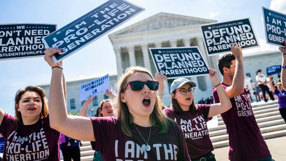 Opponents of abortion gather outside the Supreme Court as the judges weigh their final decisions of the year in Washington, DC, USA 25 June 2018