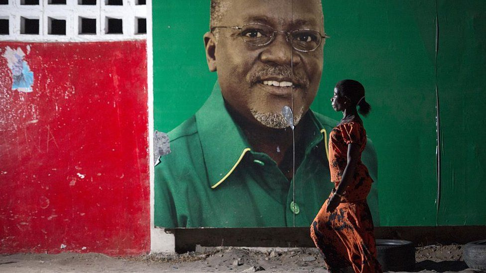 A woman walks past an election billboard after ruling party Chama Cha Mapinduzi (CCM) candidate John Magufuli (pictured on the billboard) was named president-elect by the National Electoral Commission in Dar es Salaam, on October 29, 2015.