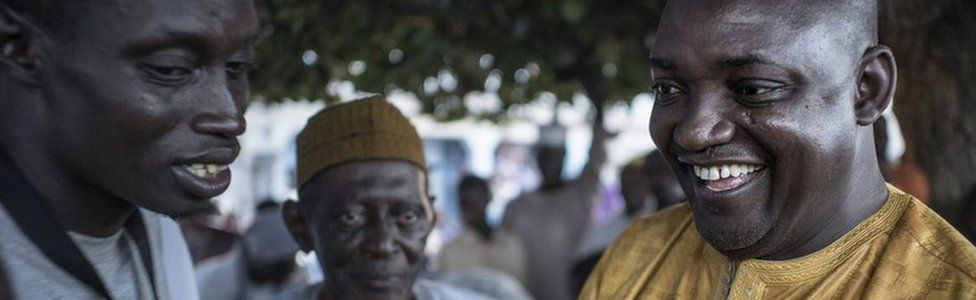 Adama Barrow chats with voters