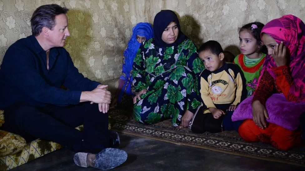 David Cameron with Syrian refugees in Lebanon