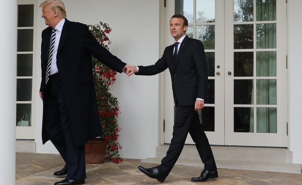 French President Emmanuel Macron (R) and US President Donald Trump (R) walk hand in hand at the White House, 24 Apr 2018