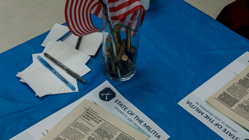 Bullets and pamphlets are pictured at a militia meeting ahead of the Virginia rally