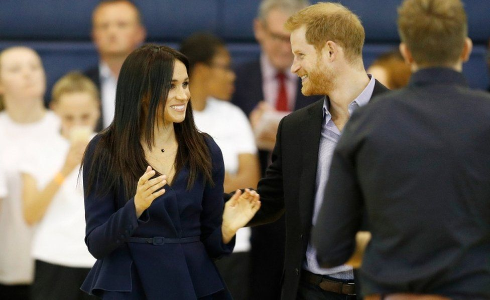 The Duke and Duchess of Sussex smile on the netball court during a masterclass at Loughborough University