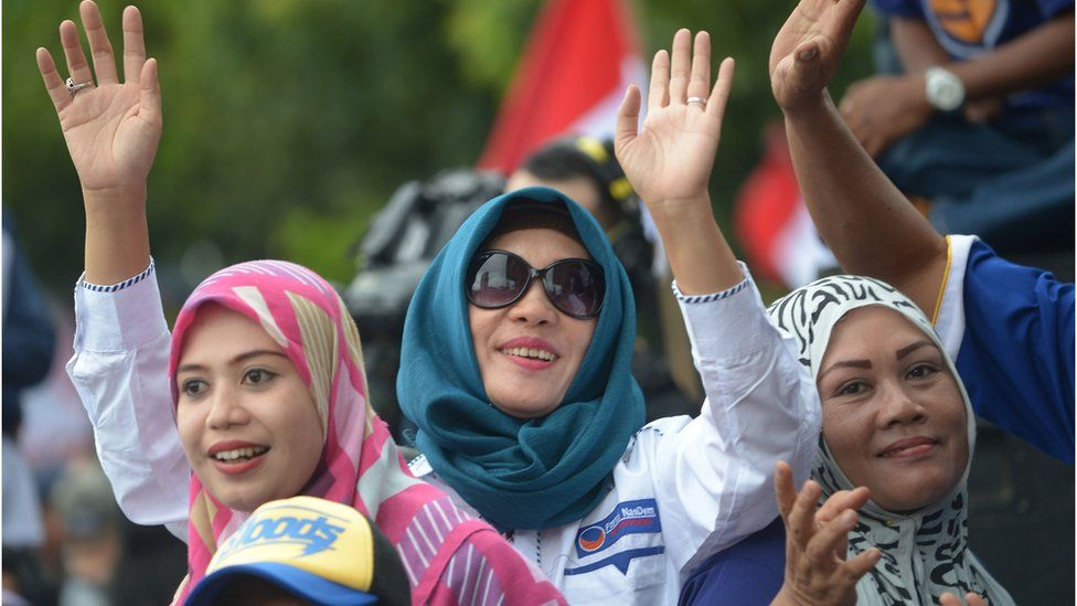 Indonesian people shout slogans as they attend a pro-government rally to call for unity in Jakarta on December 4, 2016