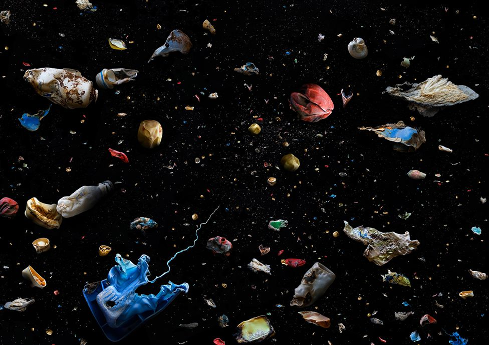 Collection of marine debris against a dark background