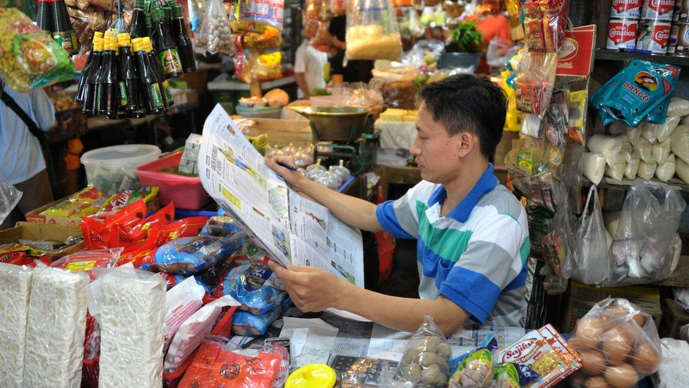 Newspaper reader in Indonesia