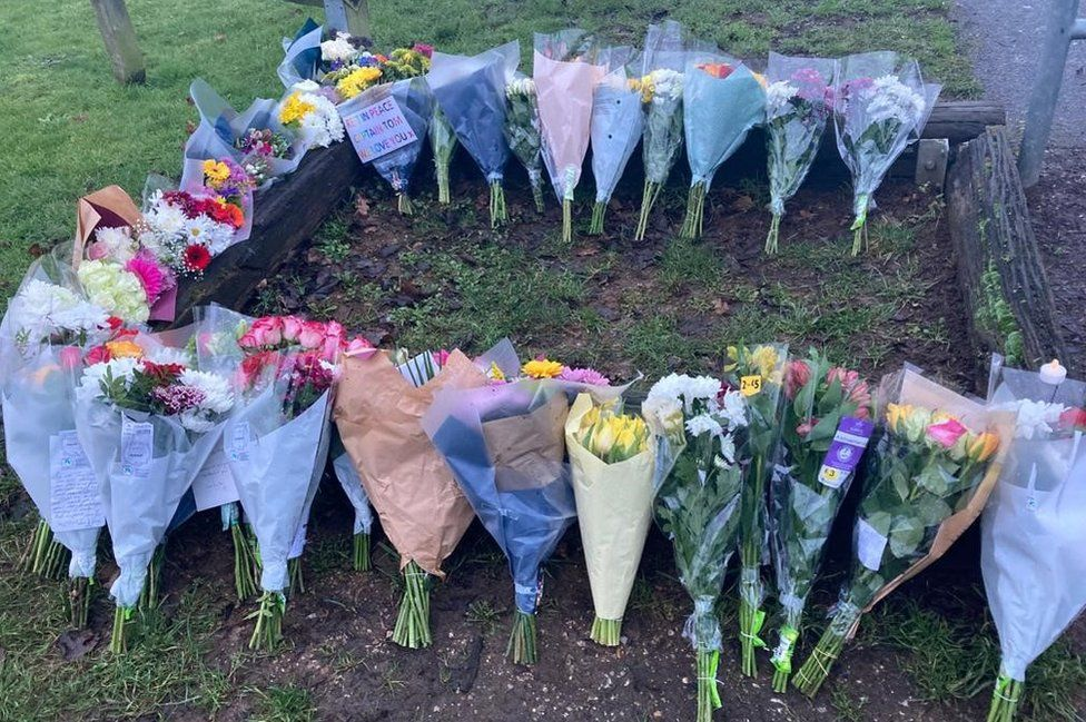 People have been leaving floral tributes outside Capt Sir Tom's home
