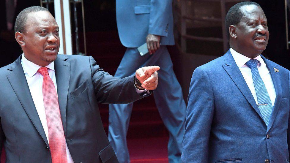 "Kenya""s President Uhuru Kenyatta (left) gestures as National Super Alliance (NASA) coalition opposition leader Raila Odinga looks on"