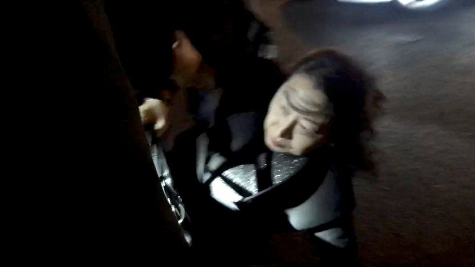 Teresa Cheng pictured falling in London