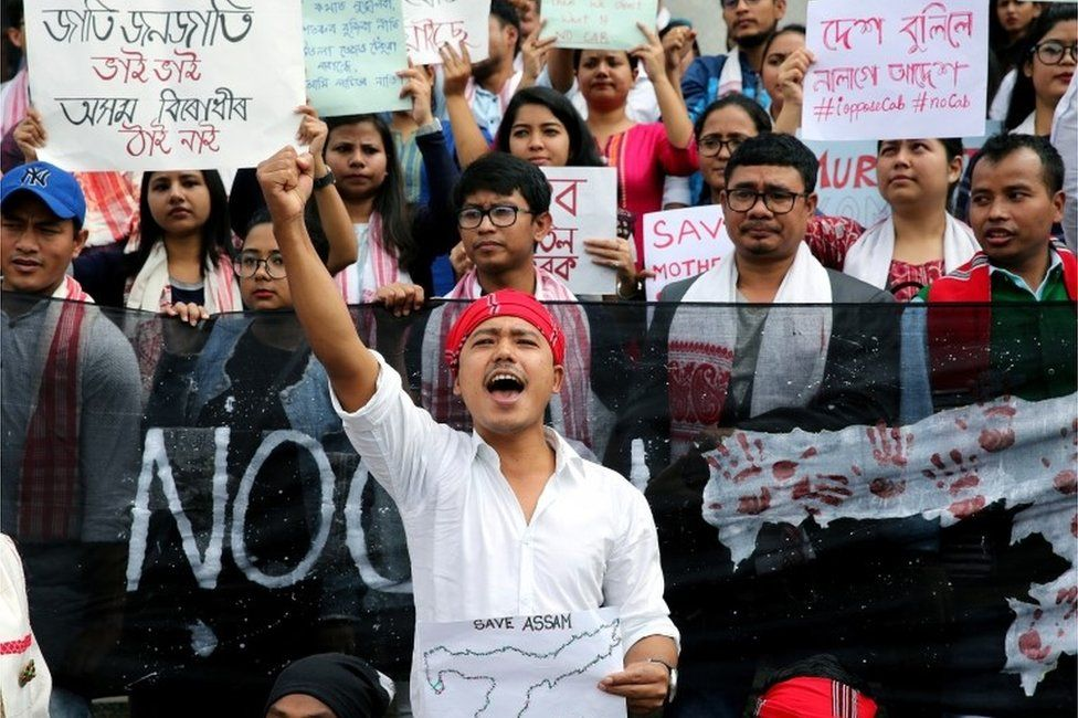 Members of the Assamese student community hold banners and shout slogans during a protest against the Citizenship (Amendment) Bill (CAB), in Bangalore, India, 14 December 2019.