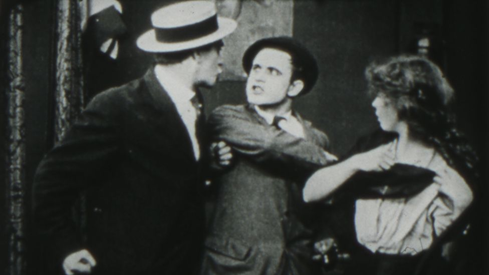 Still from The Musketeers of Pig Alley (1912)