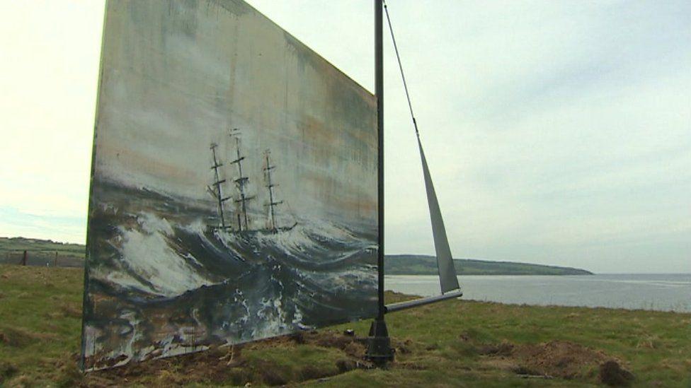 artwork on cliff