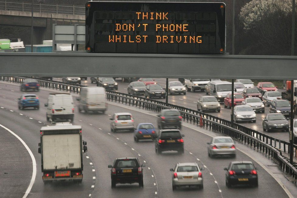 File photo from 2007 showing safety message displayed above motorway traffic.