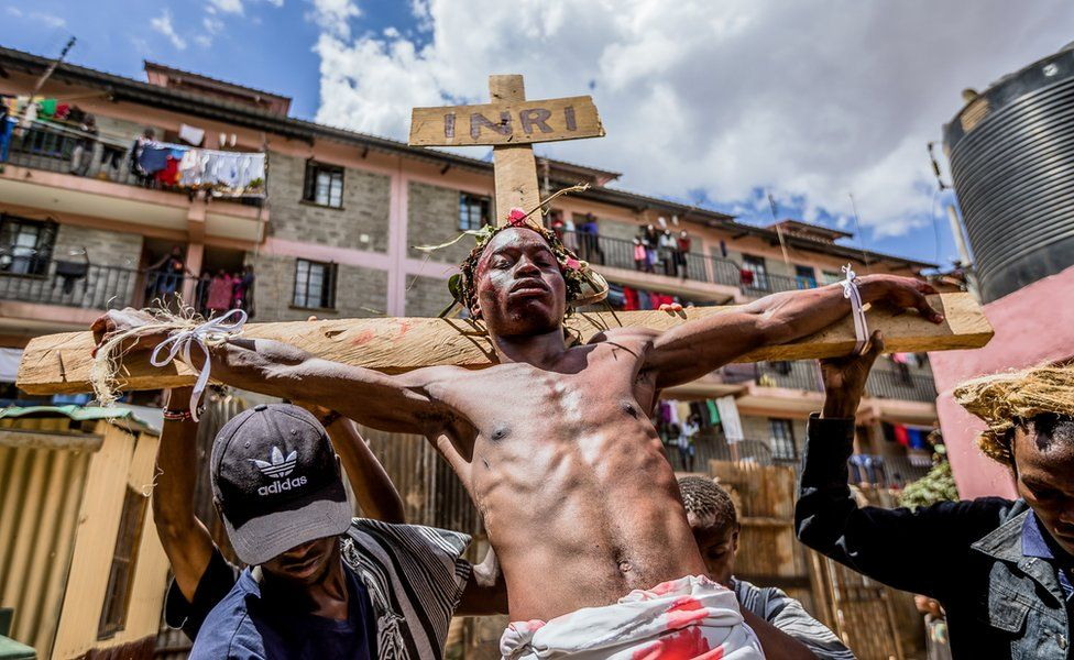 Christian devotees re-enact the Way of the Cross, or Jesus Christ's passion, during a Good Friday commemoration in the Kibera slum of Nairobi, Kenya - 19 April 2019