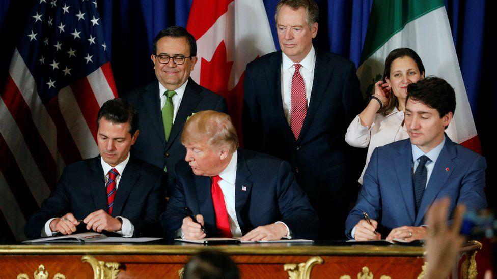 US President Donald Trump, Mexico President Enrique Pena Nieto and Canada Prime Minister Justin Trudeau attend USMCA signing ceremony