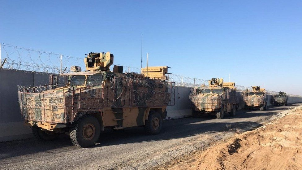 Turkish and Russian troops are seen after they completed the eighth round of joint ground patrols in northern Syria. 18 Nov 2019