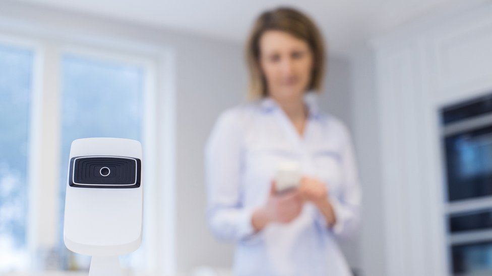 woman in home with camera device