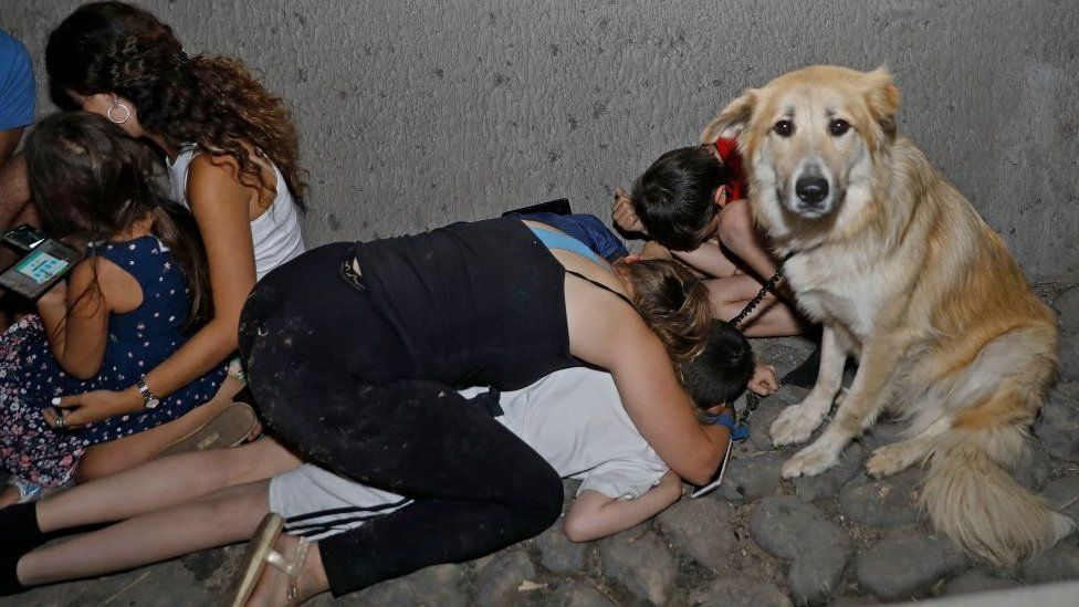 A family in Israel takes shelter under a bridge in Tel Aviv after rockets were fired from Gaza
