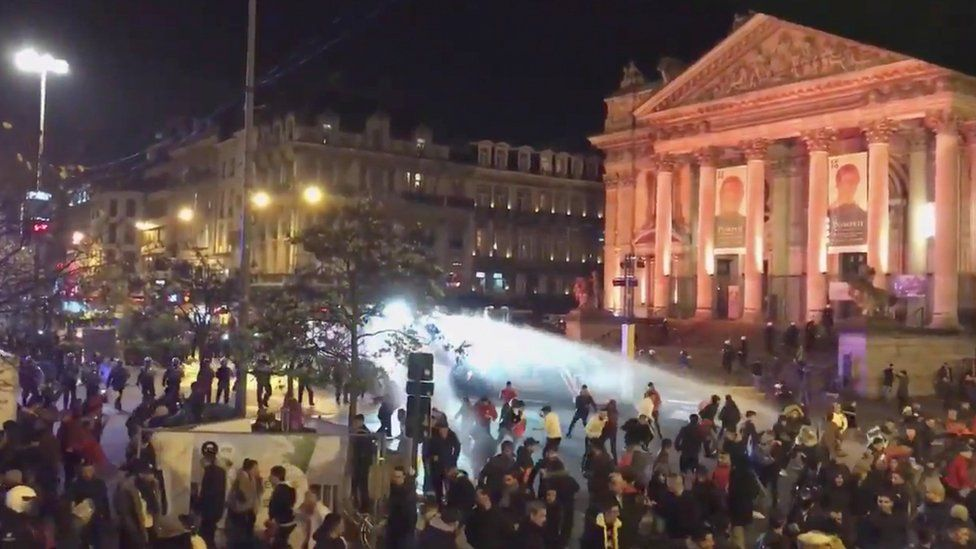police using water cannon on a crowd
