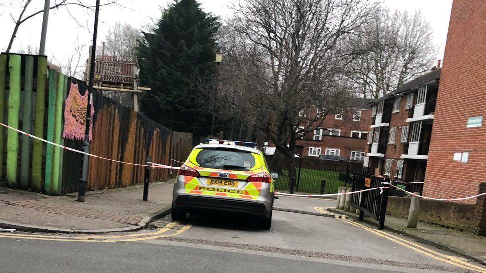 Police care and cordon on Shakspeare Walk, in Hackney, east London