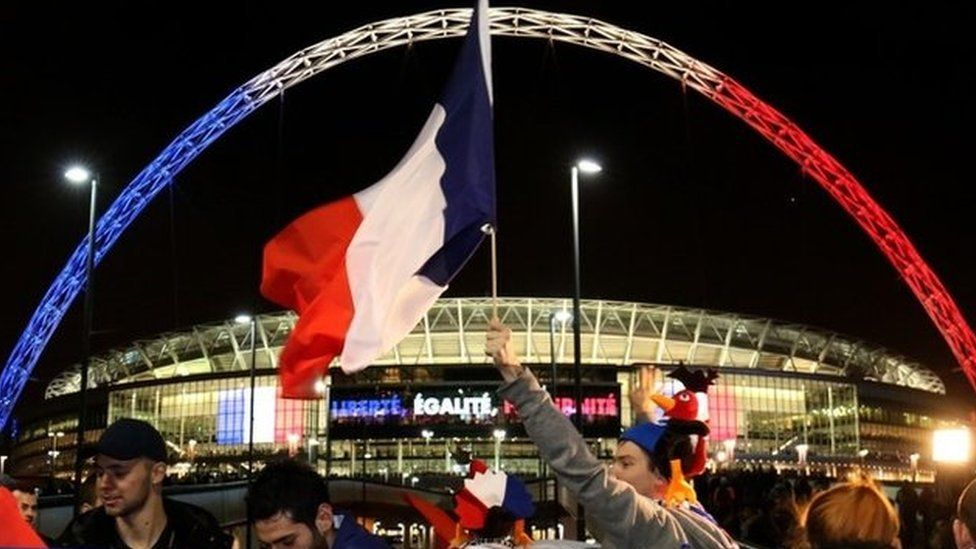Wembley Stadium lit up in French colours