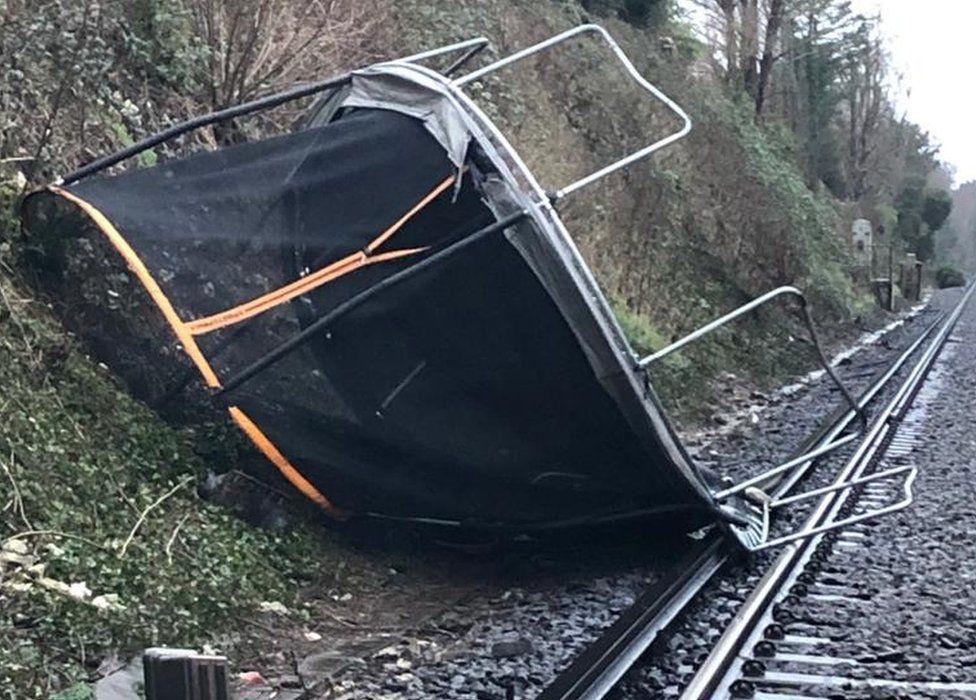 A trampoline on train tracks