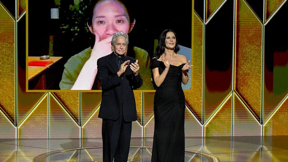 Michael Douglas and Catherine Zeta-Jones present the award for Best Picture Drama to Chloé Zhao