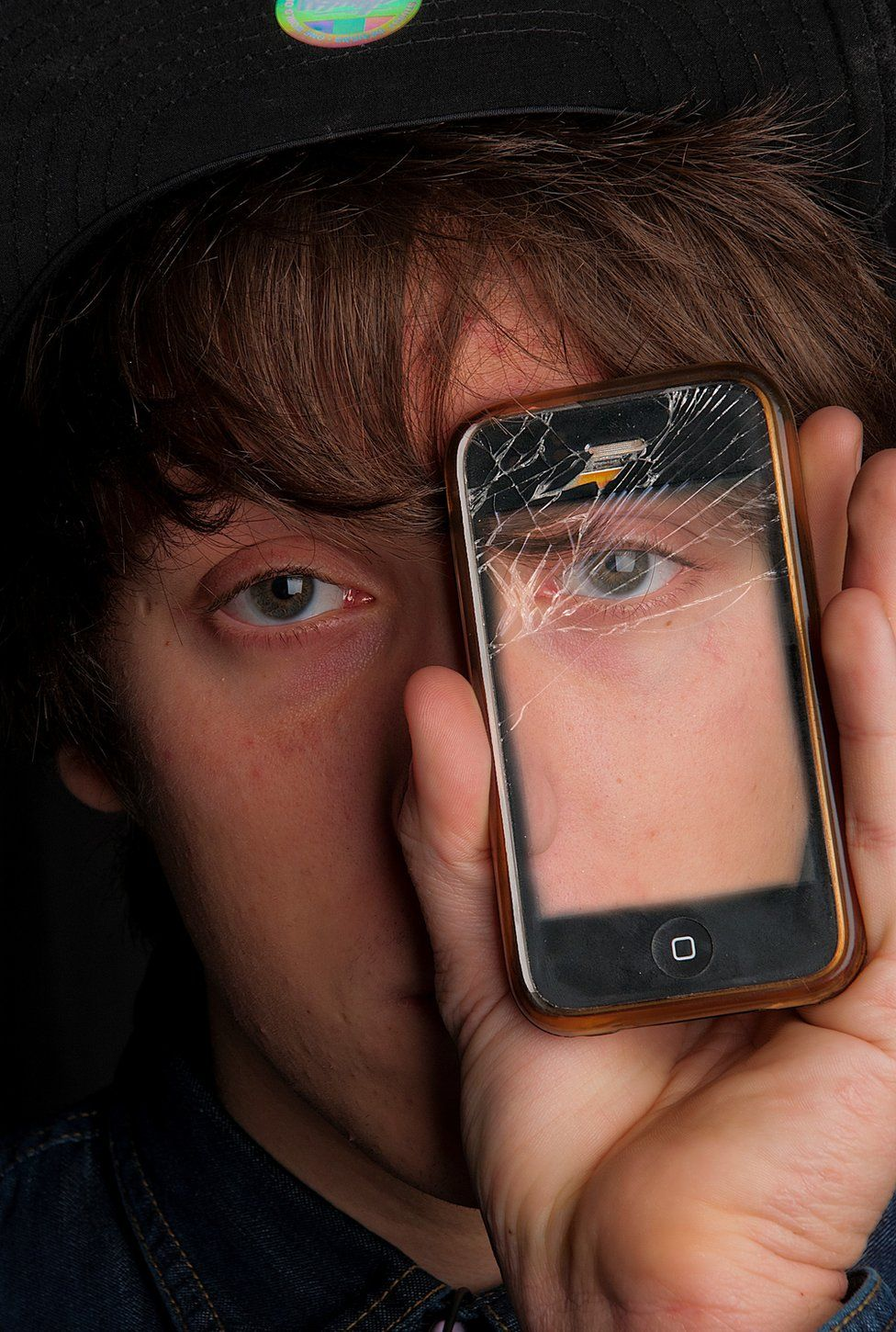 Person holding mobile phone in front of their face