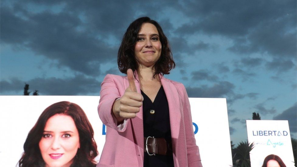 Isabel Díaz Ayuso gives the thumb up at the end of a final electoral campaign meeting ahead of Madrid's regional elections
