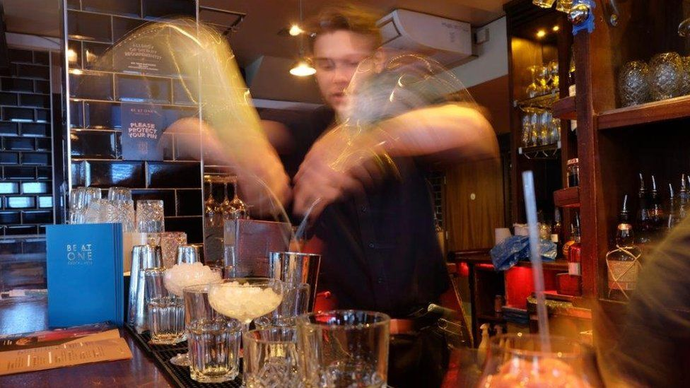 Be At One barman mixing cocktails