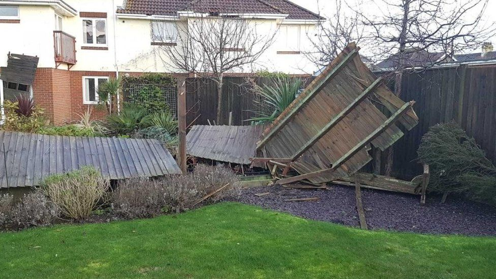 Fence panels were torn down