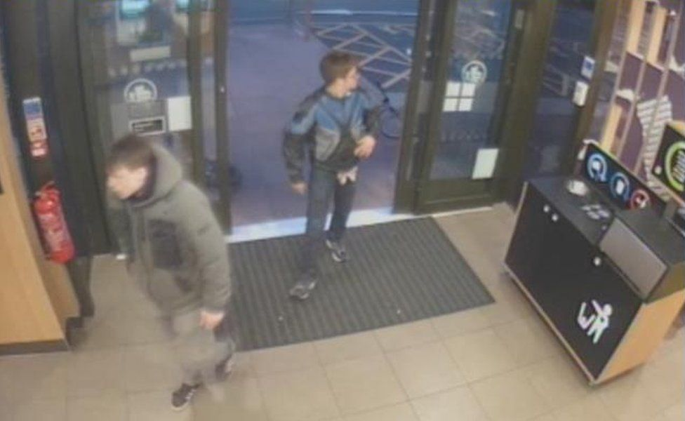 CCTV still of two defendants going onto McDonald's after the assault