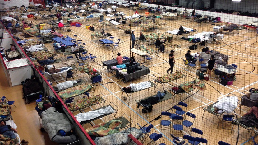 Cots are set up on the gym floor at an evacuee reception center, operated by the regional municipality of Wood Buffalo in Anzac, Alberta, Canada on Wednesday, May 4, 2016.