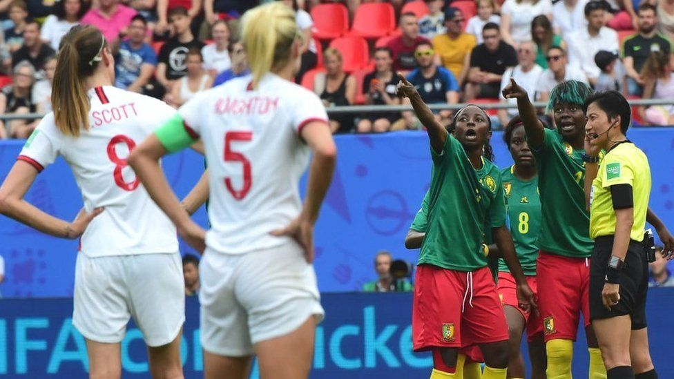 Cameroon players react to a VAR decision