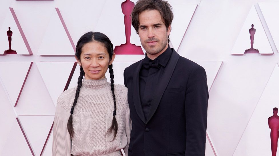 Chloe Zhao and Joshua James Richards at the Oscars