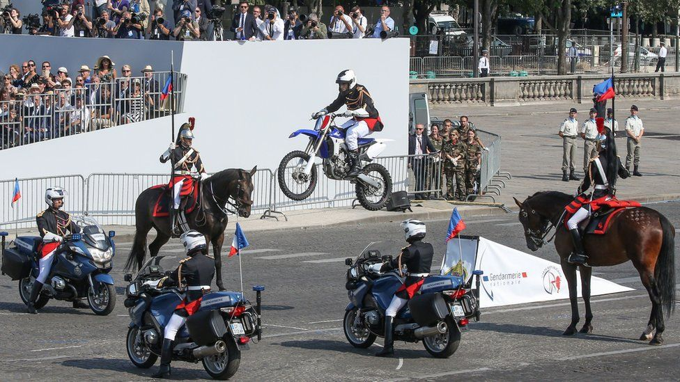 French republican guard motorcyclist doing a stunt