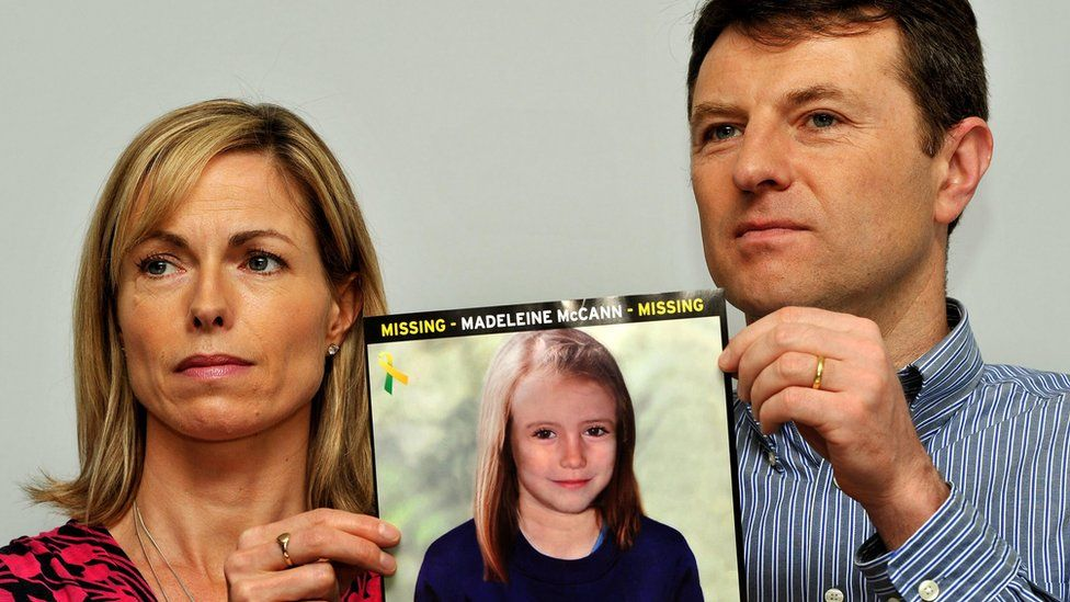 Kate and Gerry McCann with a photo of an older Madeleine McCann